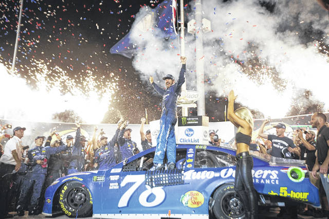 Martin Truex Jr. celebrates after winning the NASCAR Cup Series auto race Saturday at Kentucky Speedway in Sparta, Ky.