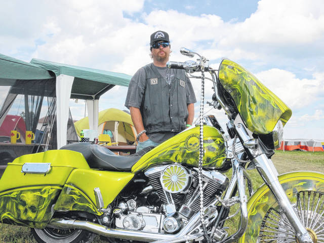 Mike Fullerton with the Iron Coffins Motorcycle Club from Lima shows off his 1998 Harley Davidson Road King.