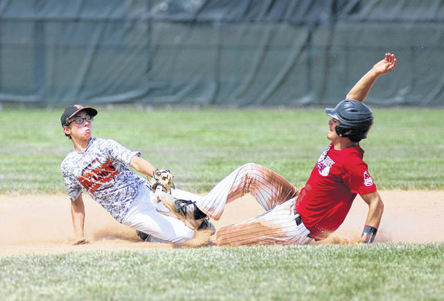 Elida second baseman Drew Biglow applies the tag on Jake Cowan on an a steal attempt during the District 5 ACME tournament Saturday.