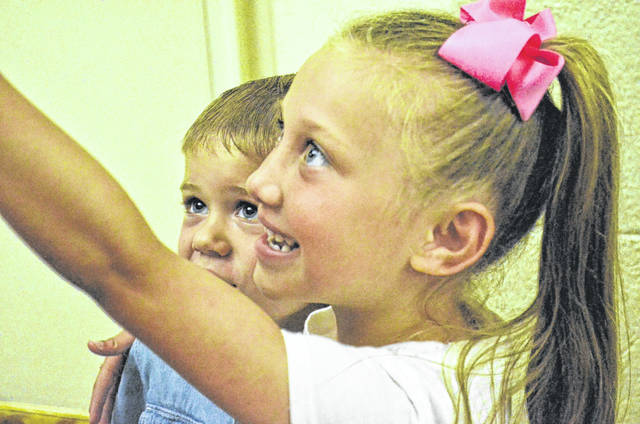 Isabella Thornburg, 5, takes a selfie with her brother Tobias Steffes, 4, after she was adopted by Gabe and Amy Thornburg Thursday and before he was adopted by Jeremy Kindle and Scott Steffes. Isabella and her sisters Elissa, 11, and Aurora, 9, were adopted by their foster parents Thursday while Tobias and his brothers Josiah, 8, and Timmy, 3, were adopted by their foster parents, Jeremy Kindle and Scott Steffes.