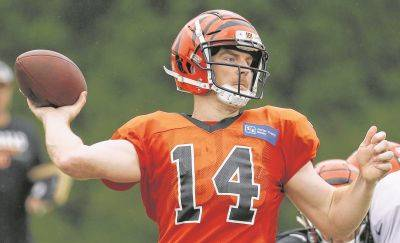 FILE - In this Monday, July 30, 2018, file photo, Cincinnati Bengals quarterback Andy Dalton participates during NFL football practice in Cincinnati. The Bengals were among the worst in the league at producing the big play last season. Quarterback Andy Dalton knows the priority this time around: Produce a lot more plays of at least 20 yards. (AP Photo/John Minchillo, File)