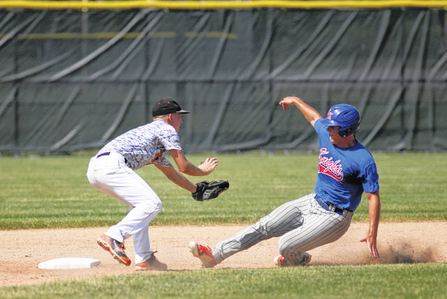 Elida shortstop Drew Biglow tags Crestview's Brody Brecht during ACME District 5 action Friday at Lima Central Catholic Friday.