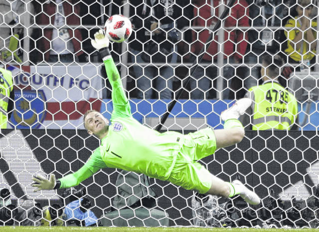 England goalkeeper Jordan Pickford saves a penalty during the round of 16 match between Colombia and England at the 2018 soccer World Cup in the Spartak Stadium, in Moscow, Russia, Tuesday.