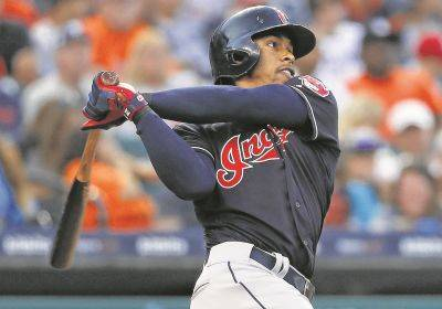 Cleveland's Francisco Lindor hits a two-run home run during Friday night's game in Detroit.