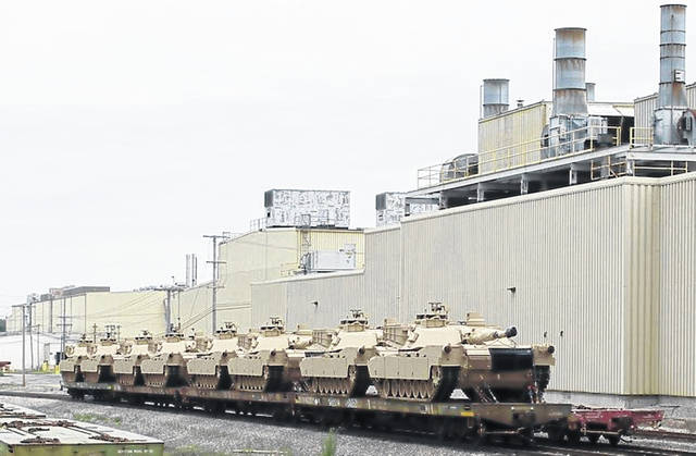 Lima is home to America's last major tank factory, an industrial throwback with its 60-foot-high ceilings, massive cranes, lasers and presses for moving, flipping and cutting the steel plates that move along an assembly line. They are loaded on rail cars for shipment. David S. Cloud | Los Angeles Times/TNS