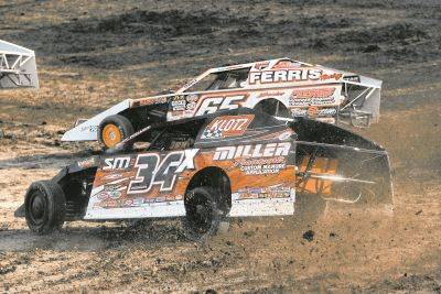 Shane O'Connor (34x) and Todd Sherman battle during Friday night racing at Limaland Motorsports Park.