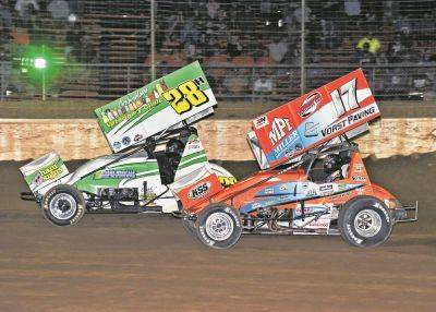 Jared Horstman (17) gets in position to pass Hud Horton during Friday night racing at Limaland Motorsports Park.