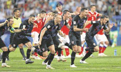 Croatia players celebrate defeating Russia in a World Cup quarterfinals shootout Saturday in Sochi, Russia.