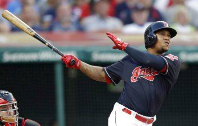 The Indians' Jose Ramirez hits a three-run home run off Cincinnati's Tanner Rainey in the third inning of Wednesday night's game in Cleveland. Francisco Lindor and Michael Brantley scored. (AP Photo)