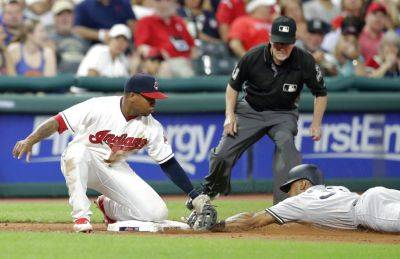 The New York Yankees' Aaron Hicks steals to third base as Cleveland Indians' Jose Ramirez is late on the tag during the eighth inning of Thursday night's game in Cleveland. (AP photo)
