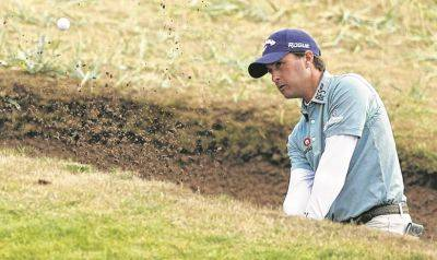 Kevin Kisner plays out of a bunker on the 14th hole during Friday's second round of the British Open in Carnoustie, Scotland.