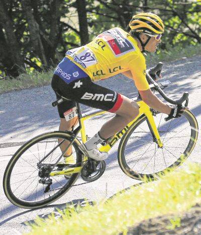 Belgium's Greg van Avermaet, wearing the overall leader's yellow jersey, speeds downhill during Tuesday during the Tour de France's 10th stage which started in Annecy and finished in Le Grand-Bornand, France.
