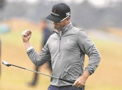 Zach Johnson celebrates after sinking a putt for a birdie on the 18th hole during Friday's second round of the British Open in Carnoustie, Scotland.