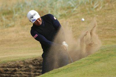 Hideto Tanihara of Japan plays out of a bunker during a Wednesday British Open practice round in Carnoustie, Scotland, (AP Photo)
