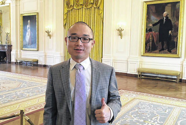 "This photo provided by Panshu Zhao shows Zhao at the White House on April 21, 2018. Zhao is one of dozens, if not more, devastated immigrant military recruits and reservists struggling this summer with abrupt and often inexplicable discharges and cancelled contracts. They enlisted with a promised path to citizenship in exchange for being willing to risk their lives for the U.S., a timeworn exchange that's added linguists, medical specialists and others to the military since the Revolutionary War. ""It's just like you're dropped from heaven to hell,"" Zhao told the Associated Press on Friday, July 6, 2018."
