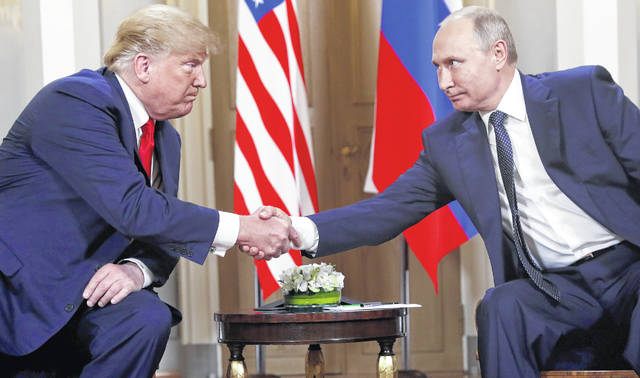U.S. President Donald Trump, left, and Russian President Vladimir Putin, right, shake hand at the beginning of a meeting at the Presidential Palace in Helsinki, Finland, on Monday. (AP Photo/Pablo Martinez Monsivais)