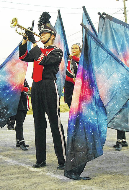 Spencerville senior Rebecca Stetler plays the trumpet surrounded by flags during last year's fair.