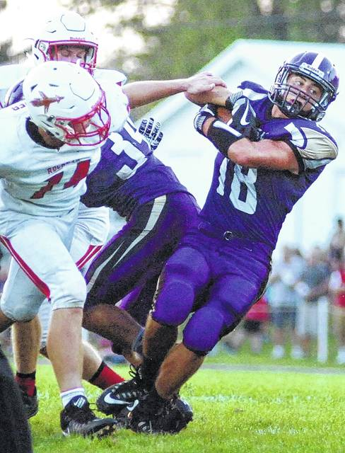 Leipsic's Cole Williamson, shown here against Pandora-Gilboa running the ball, made his impact felt on defense and was the team's top tackler.