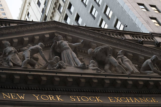 FILE- This Oct. 25, 2016, file photo shows the New York Stock Exchange at sunset in lower Manhattan. On Monday, Aug. 6, 2018, stocks are opening slightly lower on Wall Street as the market gives back some of its gains from the week before. (AP Photo/Mary Altaffer, File)