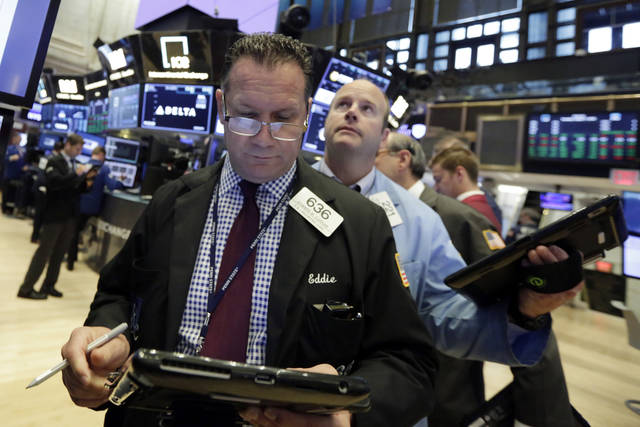 Traders Edward Curran, left, and Peter Mancuso work on the floor of the New York Stock Exchange, Tuesday, Aug. 7, 2018. Stocks are opening higher on Wall Street as technology companies and banks put up some solid gains. (AP Photo/Richard Drew)