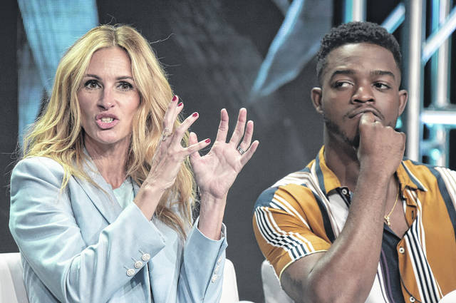 "Julia Roberts, left, and Stephan James participate in the ""Homecoming"" panel during the TCA Summer Press Tour on July 28 in Beverly Hills, Calif."