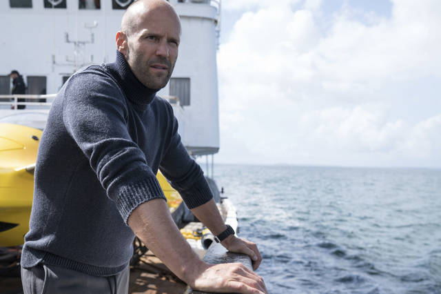 "FILE - This file image released by Warner Bros. Entertainment shows Jason Statham in a scene from the film, ""The Meg."" The shark thriller ""The Meg"" became the latest success in Hollywood's sizzling summer, opening well above expectations with $44.5 million in ticket sales, according to box office estimates Sunday."
