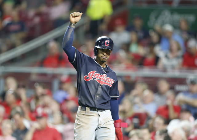Cleveland Indians' Francisco Lindor reacts after scoring on a single by Melky Cabrera, off Cincinnati Reds relief pitcher Amir Garrett during the sixth inning of a baseball game, Monday in Cincinnati.