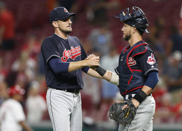 Cleveland Indians relief pitcher Dan Otero, left, and catcher Yan Gomes celebrate the team's 10-3 win over the Cincinnati Reds in a baseball game, Monday, Aug. 13, 2018, in Cincinnati. (AP Photo/Gary Landers)