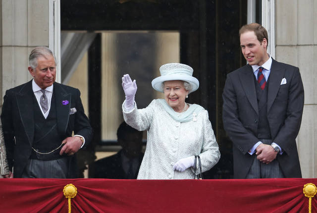 FILE - In this June 5, 2012 file photo, Queen Elizabeth II, center, accompanied by Prince Charles, left, and Prince William, appear on the balcony of Buckingham Palace in central London, to conclude the four-day Diamond Jubilee celebrations to mark the 60th anniversary of the Queen's accession to the throne. On Thursday, The Associated Press has found that stories circulating on the internet that Queen Elizabeth II will pass the crown directly to her grandson Prince William, are untrue.