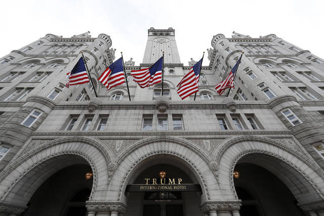 FILE - This Dec. 21, 2016 file photo shows the Trump International Hotel at 1100 Pennsylvania Avenue NW, in Washington. The Justice Department is asking a federal judge to let them file a legal appeal that could, for now, keep President Donald Trump's critics from gaining access to financial records related to his Washington hotel.