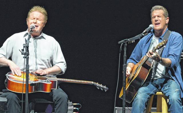 "FILE - In this Jan. 15, 2014, file photo, Don Henley, left, and Glenn Frey of The Eagles perform on the ""History of the Eagles"" tour at the Forum in Los Angeles. The Eagles' greatest hits album has surpassed Michael Jackson's ""Thriller"" as the best-selling album of all-time. (Photo by John Shearer/Invision/AP, File)"