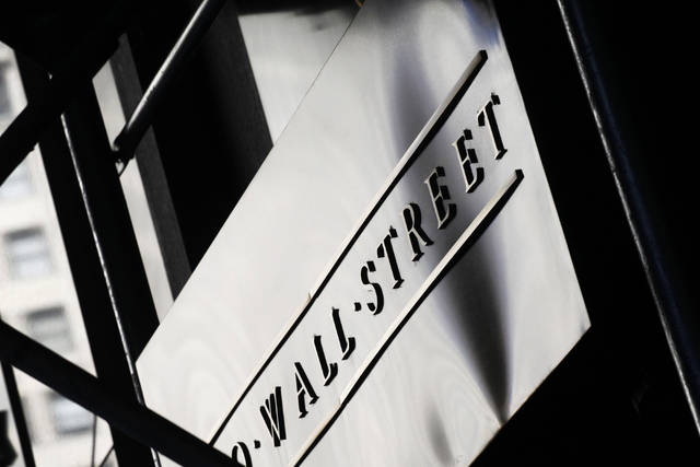 FILE - This July 15, 2013, file photo, shows a sign for Wall Street outside the New York Stock Exchange. The U.S. stock market opens at 9:30 a.m. EDT on Monday, Aug. 20, 2018. (AP Photo/Mark Lennihan, File)