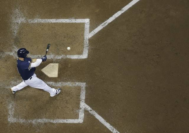 Milwaukee Brewers' Travis Shaw hits a two-run home run during the sixth inning of a baseball game against the Cincinnati Reds Monday, Aug. 20, 2018, in Milwaukee. (AP Photo/Morry Gash)