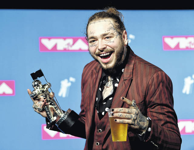 "Post Malone poses with the award for song of the year for ""Rockstar"" in the press room at the MTV Video Music Awards at Radio City Music Hall on Monday. His private jet needed an emergency landing after two tired blew on takeoff."