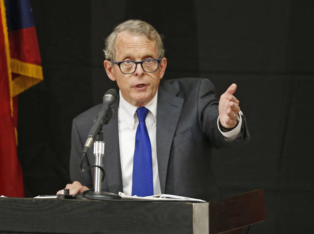 FILE – In this Aug. 2, 2017, file photo, Ohio Attorney General and former U.S. Sen. Mike DeWine discusses the opioid epidemic while speaking at the Columbus Police Academy in Columbus, Ohio. Emails released by DeWine's office show Ohio Bureau of Criminal Investigation agents and supervisors raised concerns about expired body armor for more than a year before a union grievance was filed May 3.