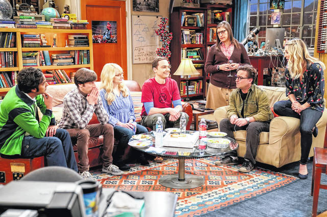 "This image released by CBS shows, from left, Kunal Nayyar, Simon Helberg, Melissa Rauch, Jim Parsons, Mayim Bialik, Johnny Galecki and Kaley Cuoco appear in a scene from the long-running comedy series ""The Big Bang Theory."" The popular series will end in 2019."