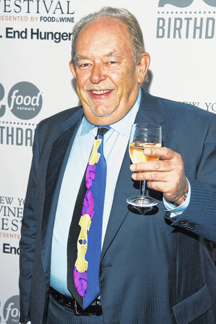 "In this Oct. 17, 2013 file photo, Robin Leach attends the Food Network's 20th birthday party in New York. Leach, whose voice crystalized the opulent 1980s on TV's ""Lifestyles of the Rich and Famous,"" died Friday."
