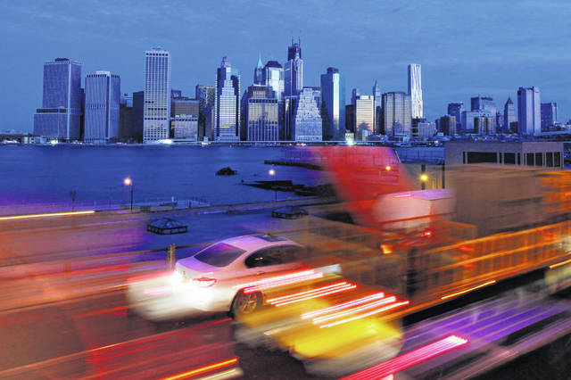 Early morning traffic in New York's Brooklyn borough moves slowly beneath the Manhattan skyline in 2012. The Trump administration announced new rules Thursday, aimed at preventing residents in high-tax states from avoiding a new cap on widely popular state and local tax deductions.