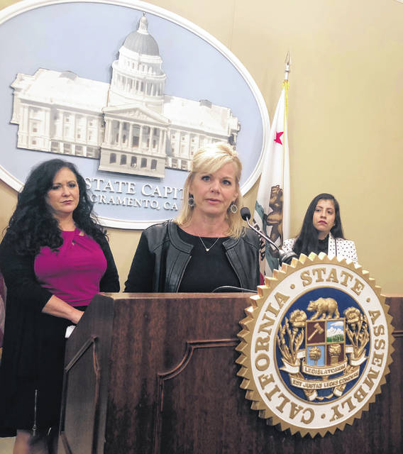 Former Fox News anchor Gretchen Carlson speaks on May 9 in support of a California bill aimed at protecting workers from forced arbitration and nondisclosure agreements during a news conference in Sacramento, Calif. The state Senate approved the bill, by Assemblywoman Lorena Gonzalez Fletcher, D-San Diego, left, and sent it to Gov. Jerry Brown on Wednesday.