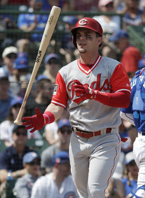 Cincinnati Reds' Scooter Gennett tosses his bat after striking out swinging during the first inning of a baseball game against the Chicago Cubs, Sunday, Aug. 26, 2018, in Chicago. (AP Photo/Nam Y. Huh)