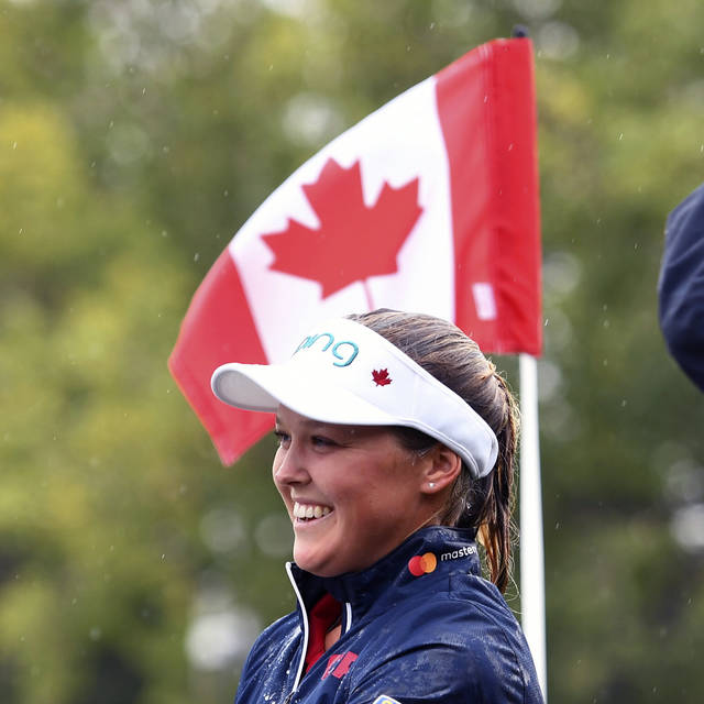 Canada's Brooke Henderson smiles after winning the Women's Canadian Open golf tournament in Regina, Saskatchewan, Sunday Aug. 26, 2018. (Jonathan Hayward/The Canadian Press via AP)