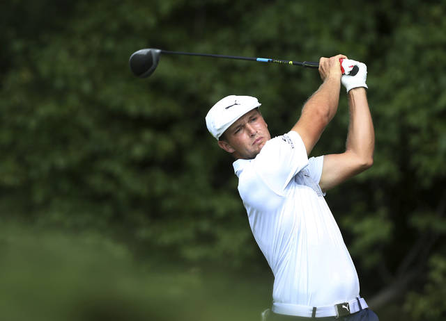 Bryson DeChambeau hits a shot on the fourth hole during the final round of the Northern Trust golf tournament, Sunday, Aug. 26, 2018, in Paramus, N.J. (AP Photo/Mel Evans)