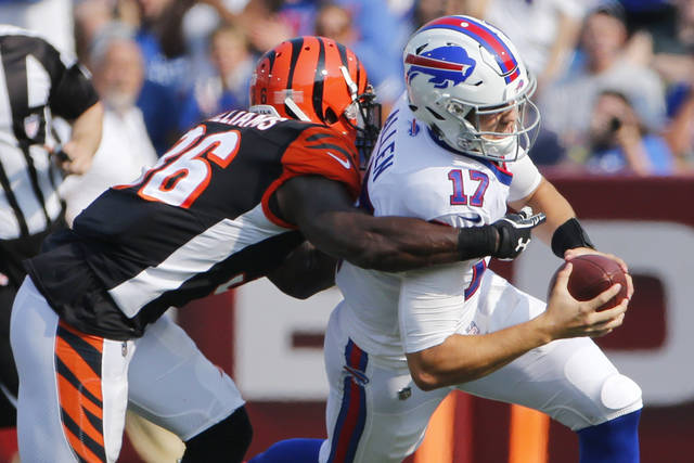 Buffalo Bills quarterback Josh Allen (17) is tackled by Cincinnati Bengals' Shawn Williams (36) during the first half of a preseason NFL football game Sunday, Aug. 26, 2018, in Orchard Park, N.Y. (AP Photo/Jeffrey T. Barnes)