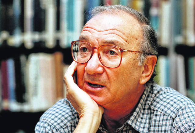 "In this Sept. 22, 1994, file photo, American playwright Neil Simon answers questions during an interview in Seattle, Wash. Simon, a master of comedy whose laugh-filled hits such as ""The Odd Couple,"" ""Barefoot in the Park"" and his ""Brighton Beach"" trilogy dominated Broadway for decades, died Sunday at the age of 91."