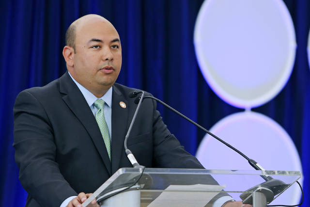 FILE – In this June 28, 2016, file photo, Ohio House Speaker Cliff Rosenberger marks the passage of legislation to rename Port Columbus International Airport to John Glenn Columbus International Airport, during an event at the airport in Columbus, Ohio. Federal investigators seized records from Rosenberger's office in 2018 as part of a federal criminal investigation into potential bribes and kickbacks surrounding payday lending legislation, according to a subpoena and search warrant released Monday in response to public records requests. Rosenberger, a Republican rising star, resigned suddenly on April 12.