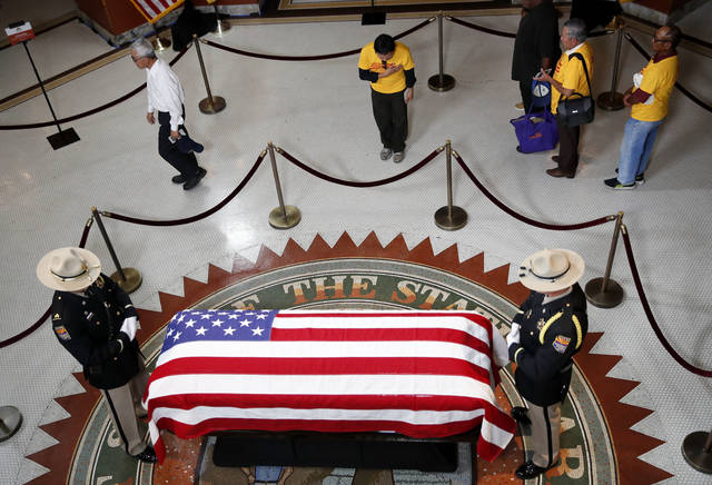 A Vietnamese group from Orange County, Calif., pays their respects near the casket of Sen. John McCain during a viewing at the Arizona Capitol on Wednesday, Aug. 29, 2018, in Phoenix. (AP Photo/Jae C. Hong)