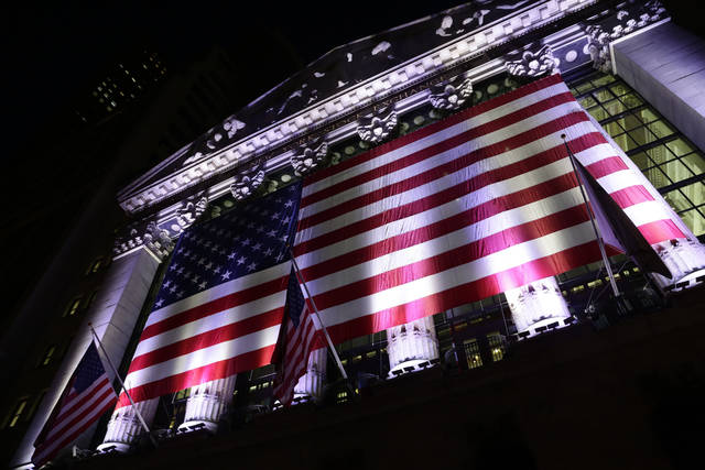 FILE- In this Feb. 17, 2017, file photo an American flag hangs on the front of the New York Stock Exchange in New York. The U.S. stock market opens at 9:30 a.m. EDT on Thursday, Aug. 30, 2018. (AP Photo/Peter Morgan, File)