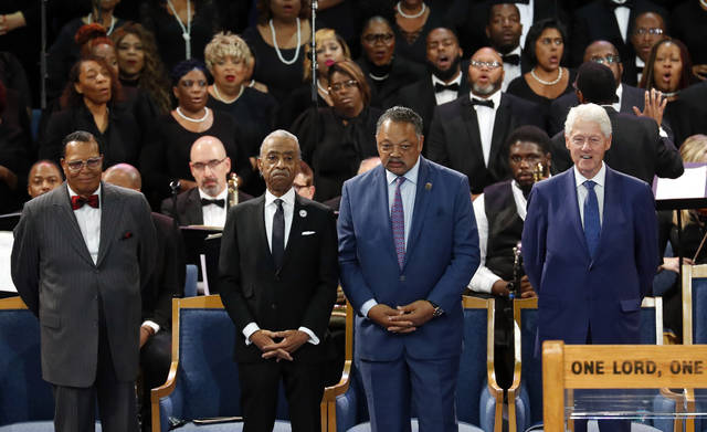 Louis Farrakhan, from left, Rev. Al Sharpton, Rev. Jesse Jackson and former President Bill Clinton attend the funeral service for Aretha Franklin at Greater Grace Temple on Friday in Detroit.