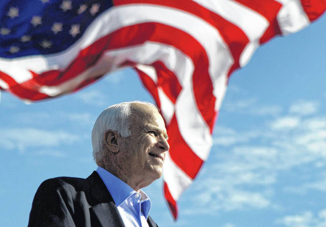 FILE - In this Nov. 3, 2008, file photo, Republican presidential candidate Sen. John McCain, R-Ariz., speaks at a rally in Tampa, Fla. According to an aide, the senator, war hero and GOP presidential candidate died Saturday. He was 81.