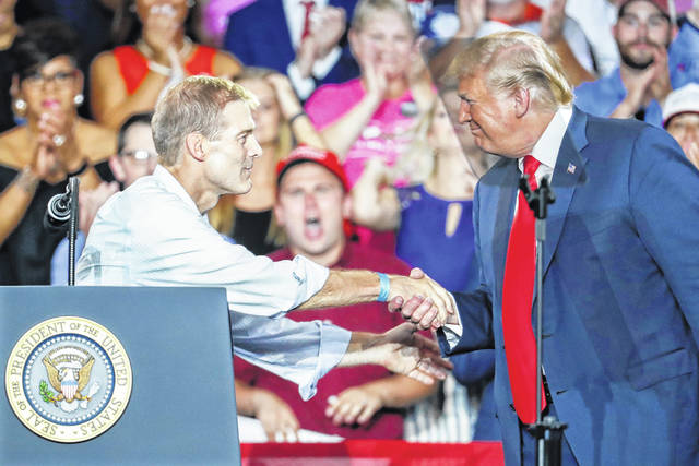 President Donald Trump, right, shakes hands with Rep. Jim Jordan, R-Ohio, left, during a rally, Saturday, Aug. 4, 2018, in Lewis Center, Ohio.